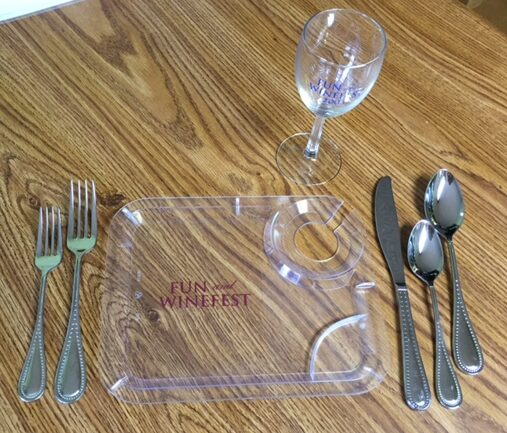 disposable dinnerware (fork, knife, spoon, wine glass and plate)